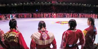 Tia Wood Heads a Sea of Red Jingle Dancers 2017 GON Tribute